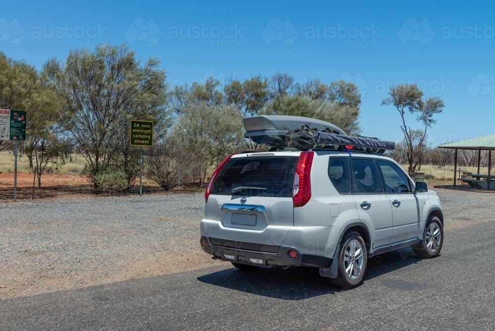White car with pod and tent on roof - Australian Stock Image
