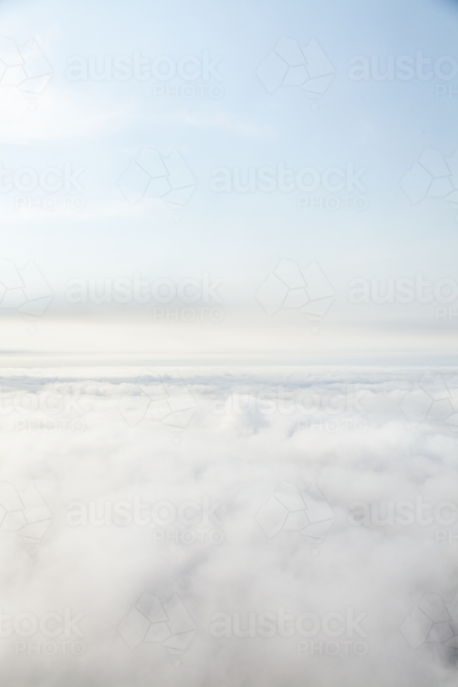 White clouds filling sky seen from above - Australian Stock Image