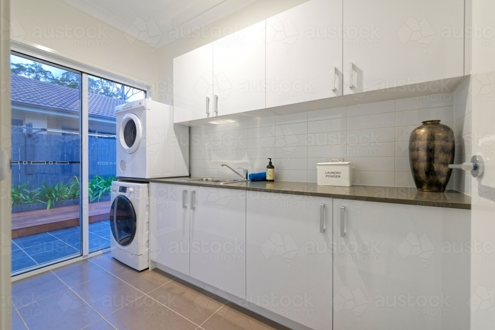 White Modern Laundry With Washing Machine And Clothes Dryer Cabinet Bench Top Australian Stock