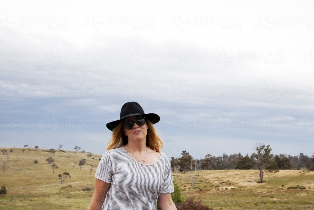 Woman walking on a farm - Australian Stock Image