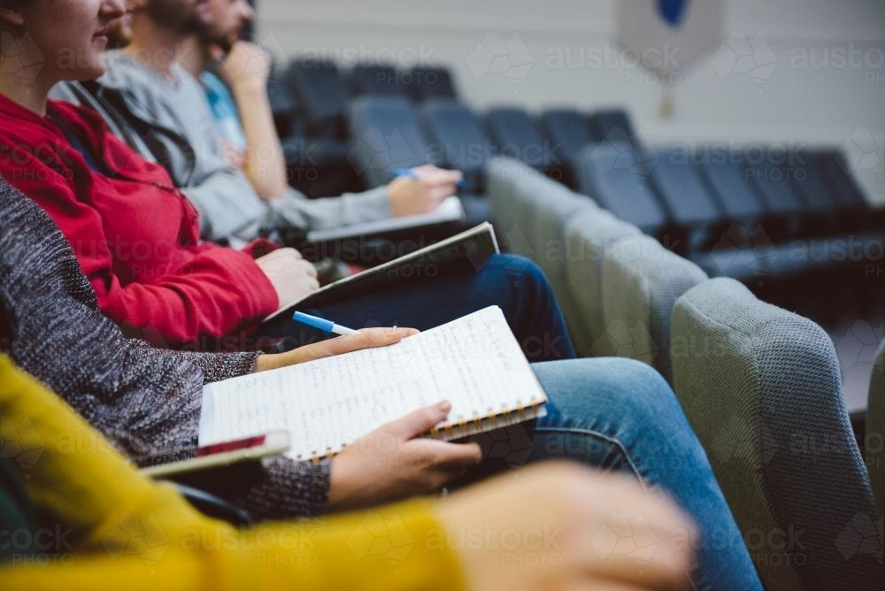 Young adult students in a university lecture hall - Australian Stock Image