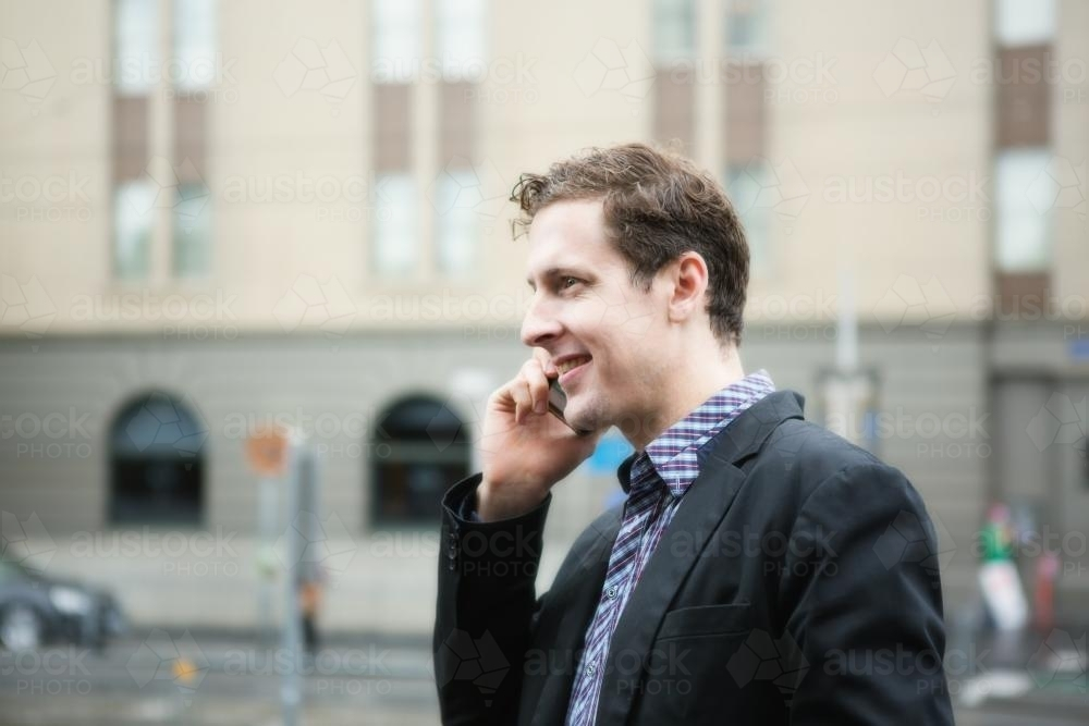 Young business man talking on mobile phone in CBD - Australian Stock Image