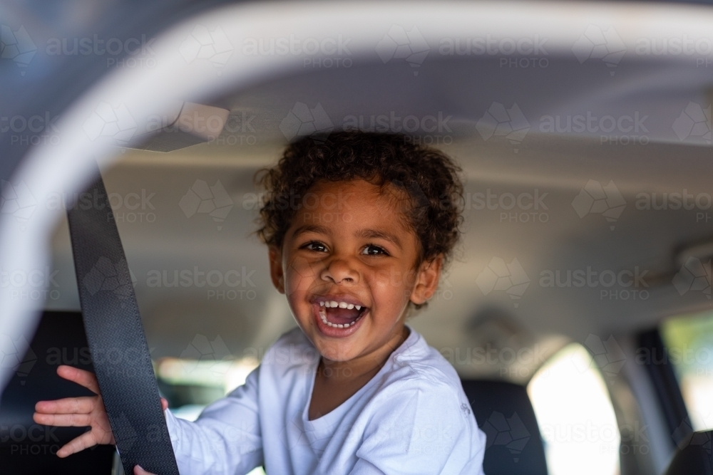 young child playing inside a van - Australian Stock Image