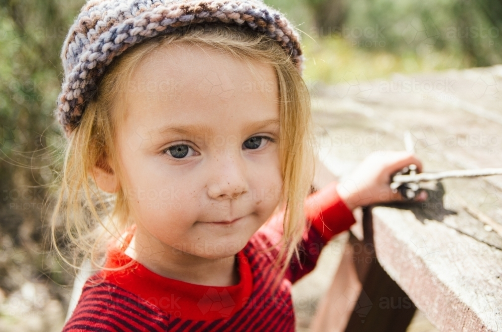 Young girl at a picnic table - Australian Stock Image
