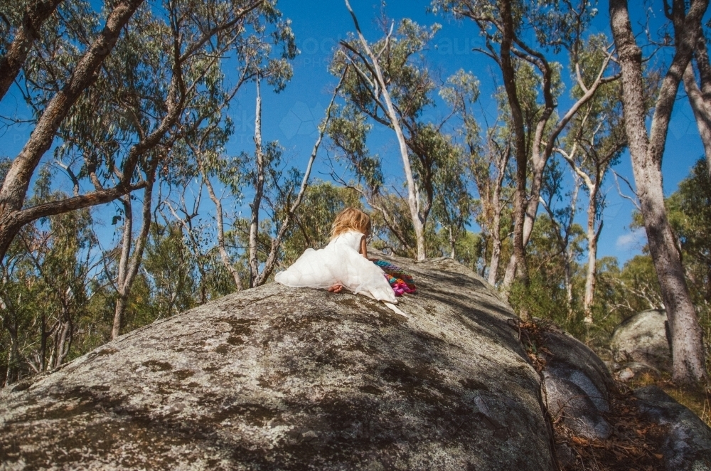 Young girl playing on a rock - Australian Stock Image