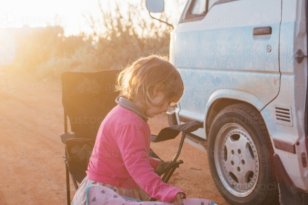 Young girl standing by campervan - Australian Stock Image