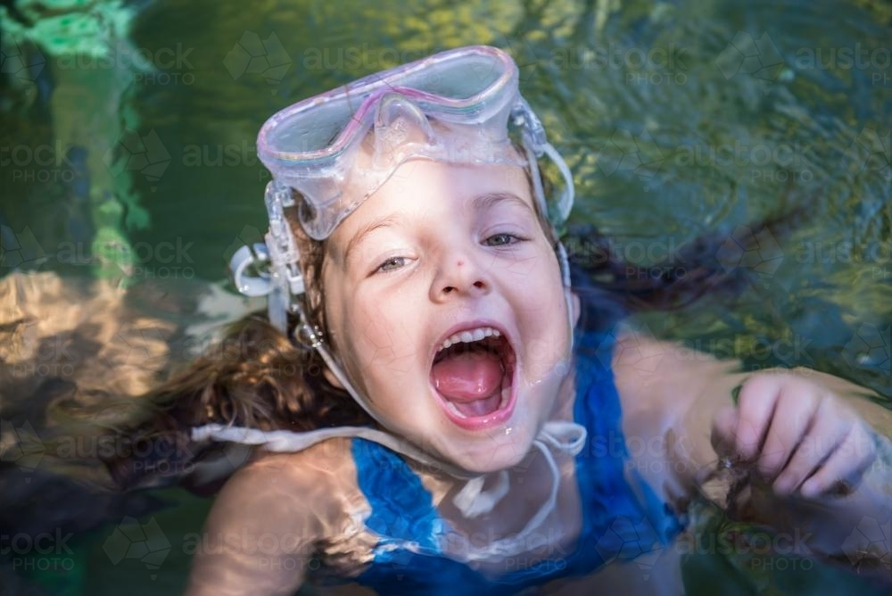 Young girl swimming at Berry Springs - Australian Stock Image