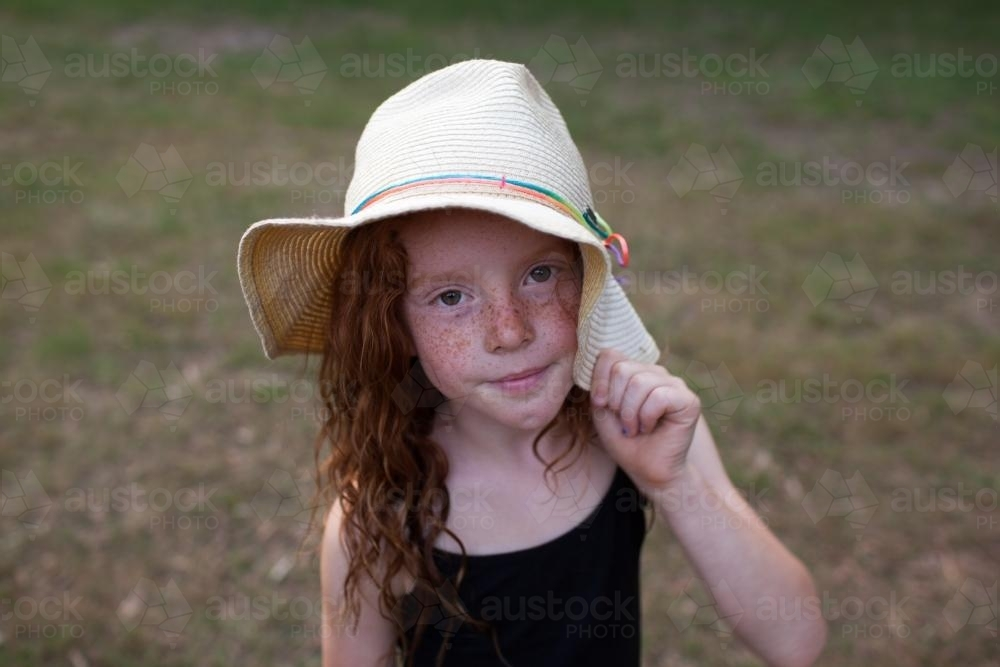 Young girl wearing a floppy hat - Australian Stock Image