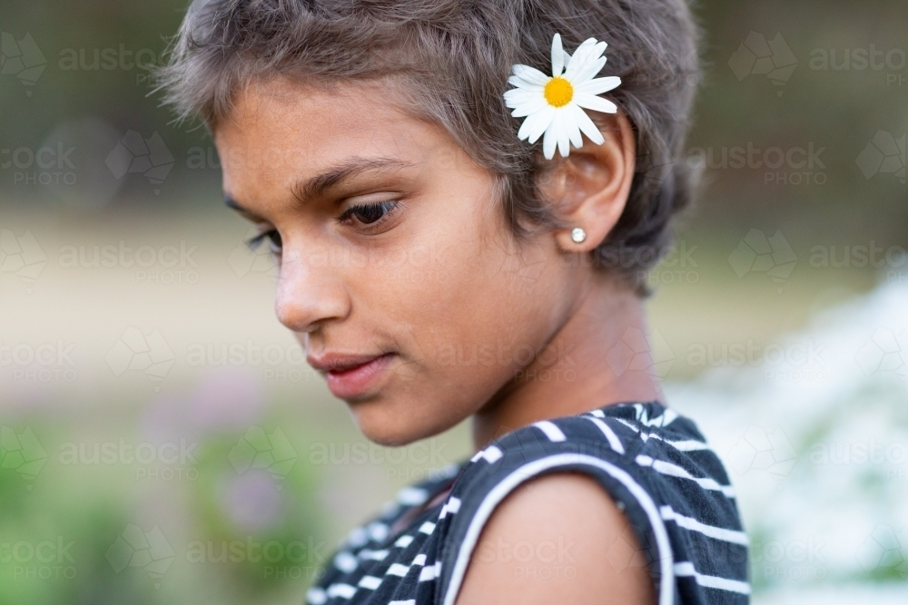 young girl with daisy in her hair - Australian Stock Image