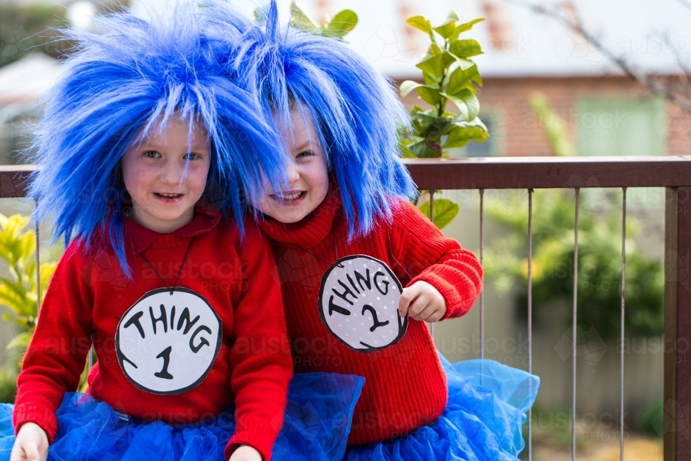 young girls dressed up as book characters Thing One and Thing Two for book week parade - Australian Stock Image
