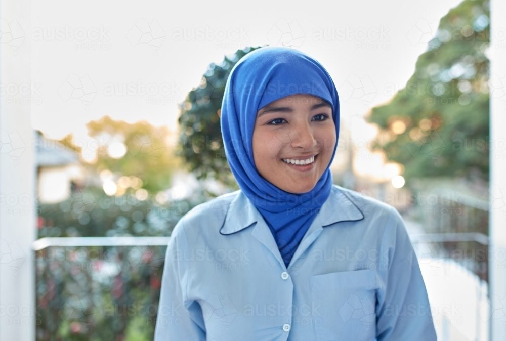 Young Muslim High School student laughing on-campus - Australian Stock Image