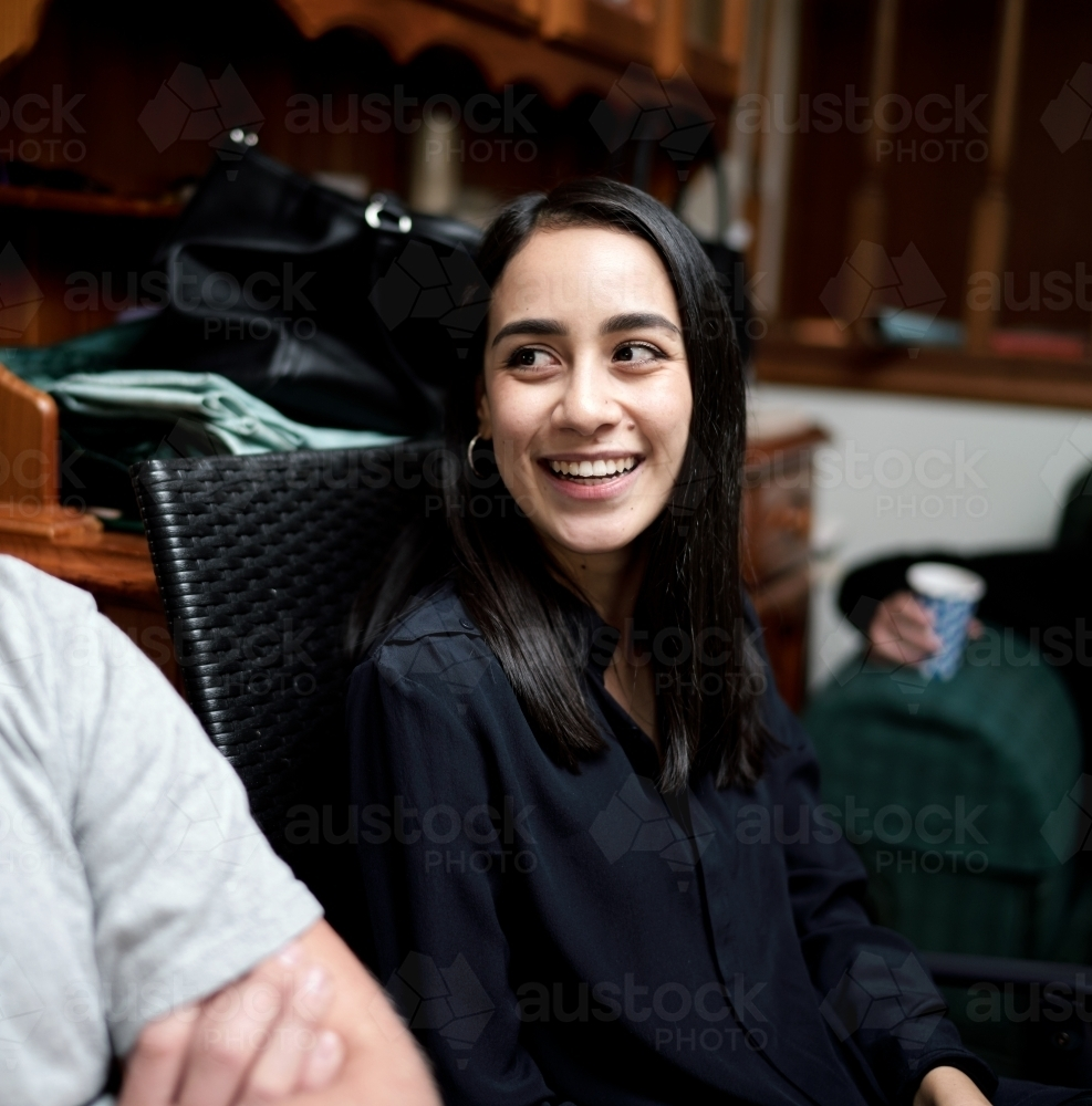 Young Smiling Woman with Straight Dark Hair - Australian Stock Image