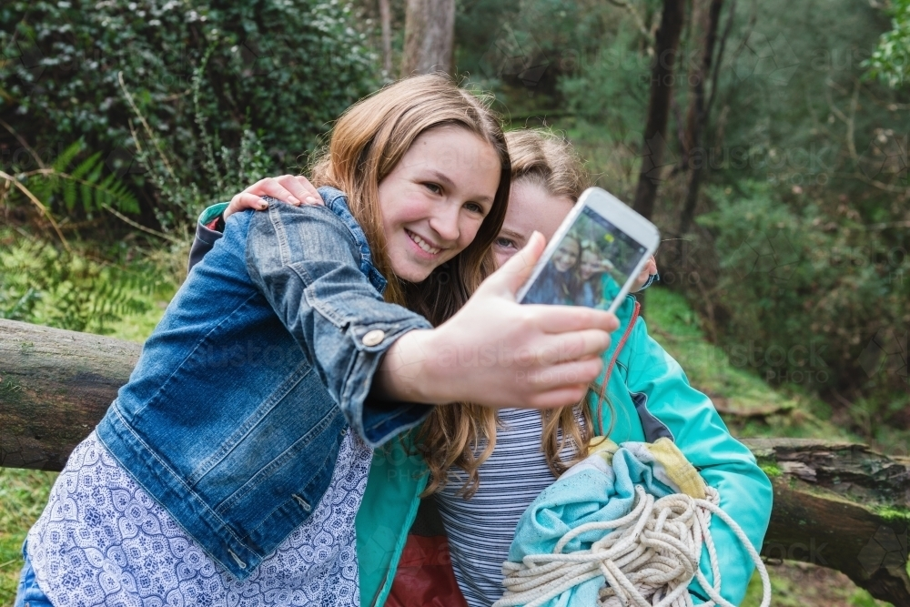 image of young teen girls take a selfie together - austockphoto