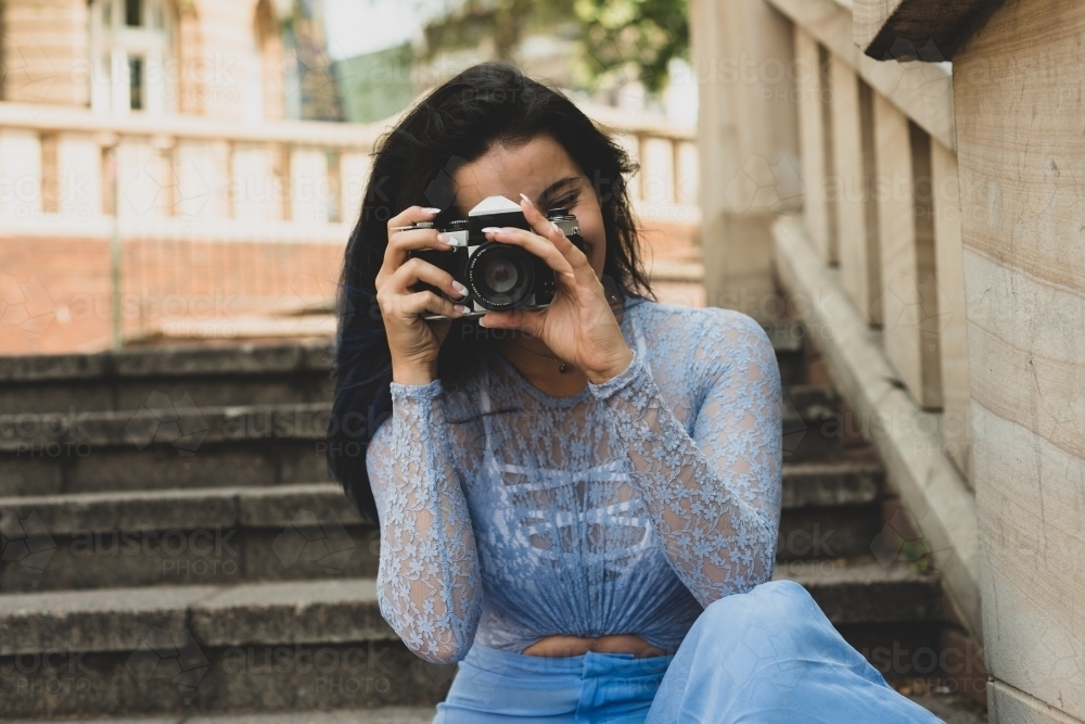 young woman with film camera - Australian Stock Image