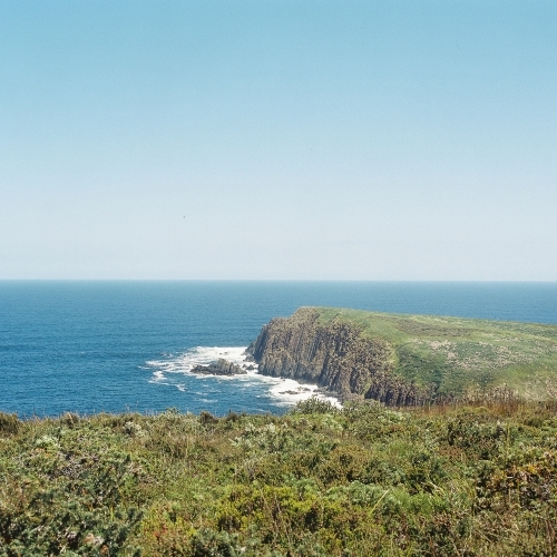 Ocean Landscape with Green Rocky Headland