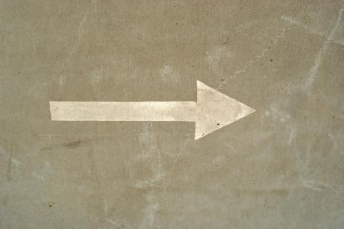 Arrow painted on the road, pointing to the right