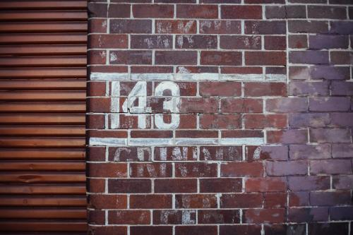 143 painted on brick wall