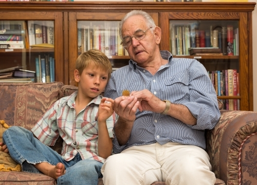 Young boy with grandfather on couch