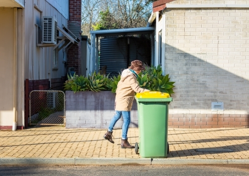 Putting rubbish bin out on the street