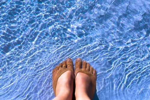 Feet cooling off in cool clear water
