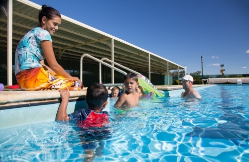 Family with young children in swimming pool