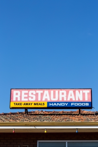 Restaurant sign, with blue sky