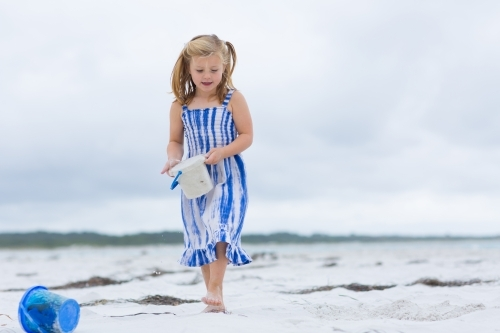 Child on the beach with buckets