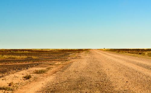 Dirt road through the Gibber Country to the Simpson Desert
