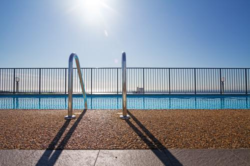 Graphic lines and patterns in swimming pool with sun flare