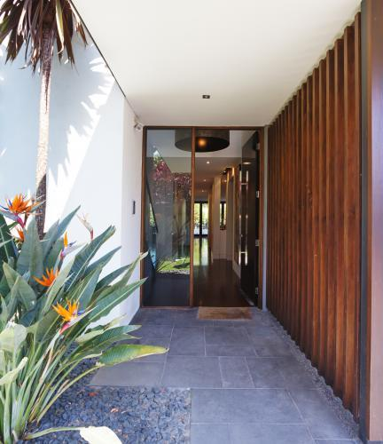 Paved and glass entrance to a contemporary home