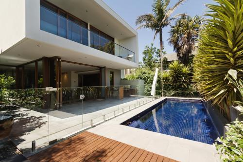 Rear landscaped yard with pool of architect designed home