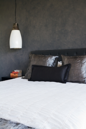 Masculine bedroom decor dark grey painted feature wall
