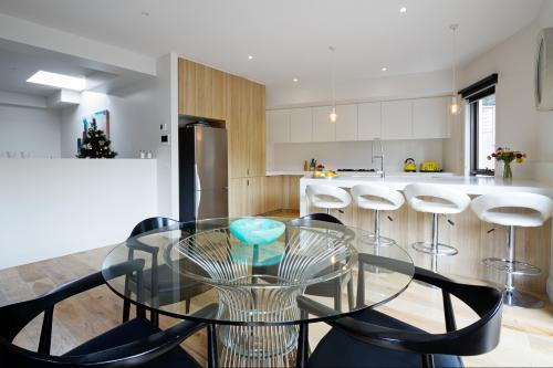Kitchen with island bench and open plan dining area