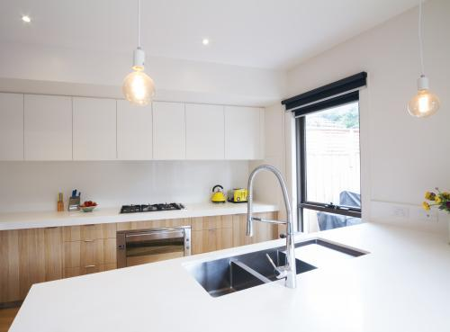 Modern kitchen with pendant lighting and sunken sink in bench