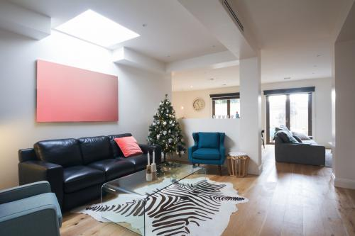 Open plan casual living room in contemporary home with christmas tree