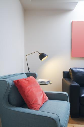 Close up of comfortable reading nook in contemporary home with lamp on side table