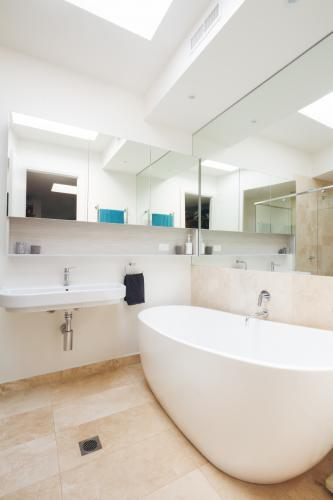 Master bathroom clean white with large bathtub in luxury home