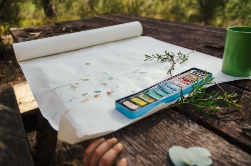 Watercolour painting at a picnic table
