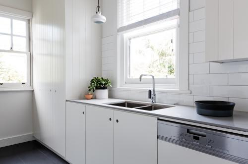 White and charcoal new renovated galley style Australian apartment kitchen