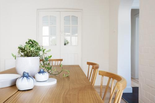 Close up details of scandi styled decor in contemporary dining room home interior