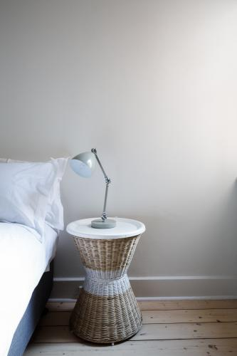 Close up details of bedside table with lamp and copy space