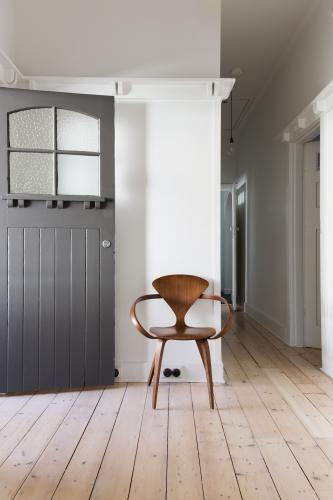 Simple decor of classic wooden chair in renovated apartment entry