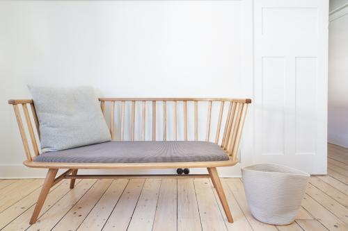Bench seat feature chair in Danish styled white interior