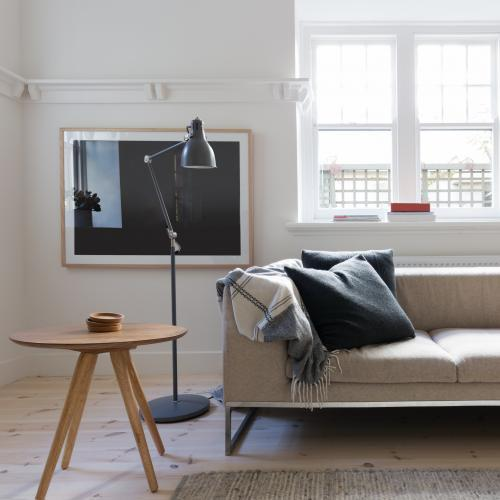 Scandi styled living room interior in art deco apartment
