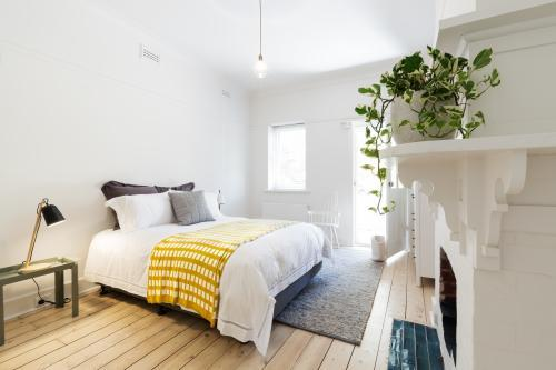 Luxury guest bedroom in vintage scandi styled Australian home