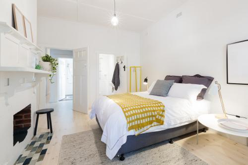 Stylish contemporary bedroom with ensuite and yellow decor accents