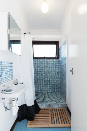 Retro blue mosaic tiled shower bathroom in Australian holiday house