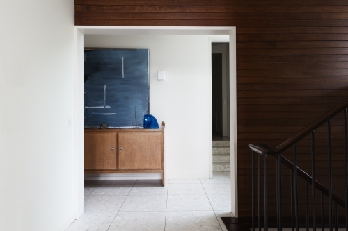 Wood panel wall detail and entry foyer in mid century modern home