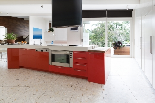 Orange kitchen cabinets in island bench in modern luxury home
