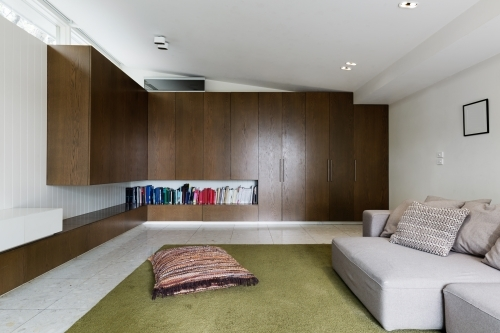 Built in walnut veneer cabinetry in modern living room interior